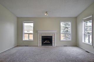 Photo 4: 70 Tararidge Circle NE in Calgary: Taradale Row/Townhouse for sale : MLS®# A1131868