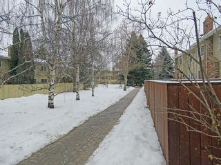 Photo 39: 373 Point Mckay Gardens NW in Calgary: Point McKay Row/Townhouse for sale : MLS®# A1063969