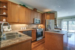 Photo 5: 17 11 Scarpe Drive SW in Calgary: Garrison Woods Row/Townhouse for sale : MLS®# A1103969