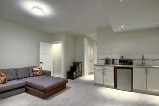 Photo 32: 309 26 Avenue NE in Calgary: Tuxedo Park Semi Detached for sale : MLS®# A1070057