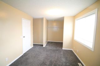 Photo 8: 80 Martinbrook Road NE in Calgary: Martindale Detached for sale : MLS®# A1092833