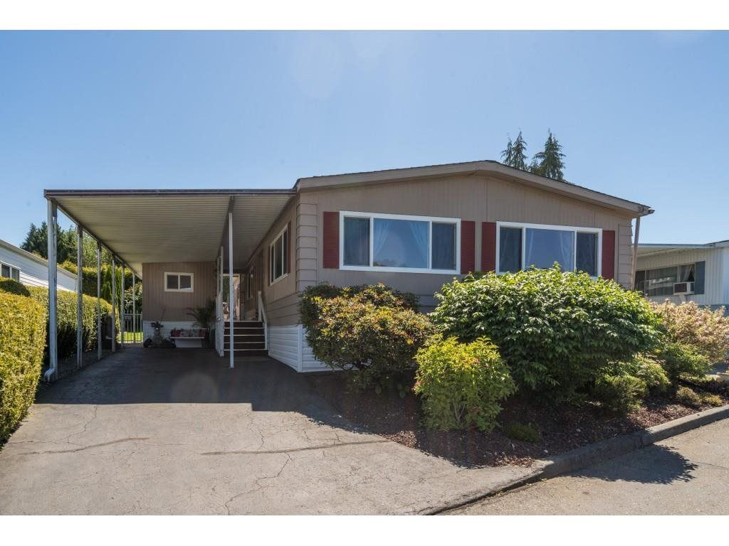 """Main Photo: 34 8254 134 Street in Surrey: Queen Mary Park Surrey Manufactured Home for sale in """"WESTWOOD ESTATES"""" : MLS®# R2586681"""