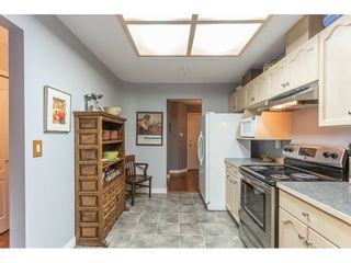 """Photo 4: 212 19241 FORD Road in Pitt Meadows: Central Meadows Condo for sale in """"Village Green"""" : MLS®# R2325248"""