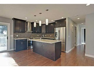 Photo 3: 27 Meadowview Road SW in Calgary: Meadowlark Park Detached for sale : MLS®# A1084197