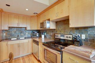 Photo 3: 802 14 Ave SW in Monticello Estates: Apartment for sale : MLS®# C4019486