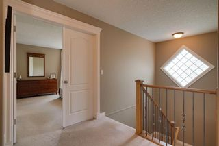Photo 19: 140 Strathlea Place SW in Calgary: Strathcona Park Detached for sale : MLS®# A1145407