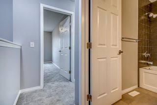 Photo 27: 129 Windstone Park SW: Airdrie Row/Townhouse for sale : MLS®# A1137155