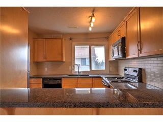 Photo 17: 248 54 GLAMIS Green SW in Calgary: Glamorgan House for sale : MLS®# C4109785