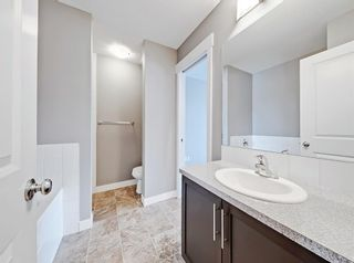 Photo 12: 482 RAINBOW FALLS Drive: Chestermere Row/Townhouse for sale : MLS®# A1050827