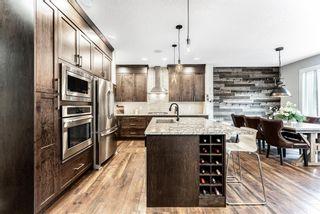 Photo 7: 61 Sundown Terrace: Cochrane Detached for sale : MLS®# A1112362