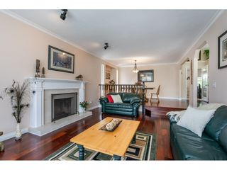 """Photo 6: 6495 180 Street in Surrey: Cloverdale BC House for sale in """"Orchard Ridge"""" (Cloverdale)  : MLS®# R2396953"""