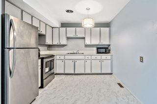 Photo 4: 73 Penworth Close SE in Calgary: Penbrooke Meadows Row/Townhouse for sale : MLS®# A1154319