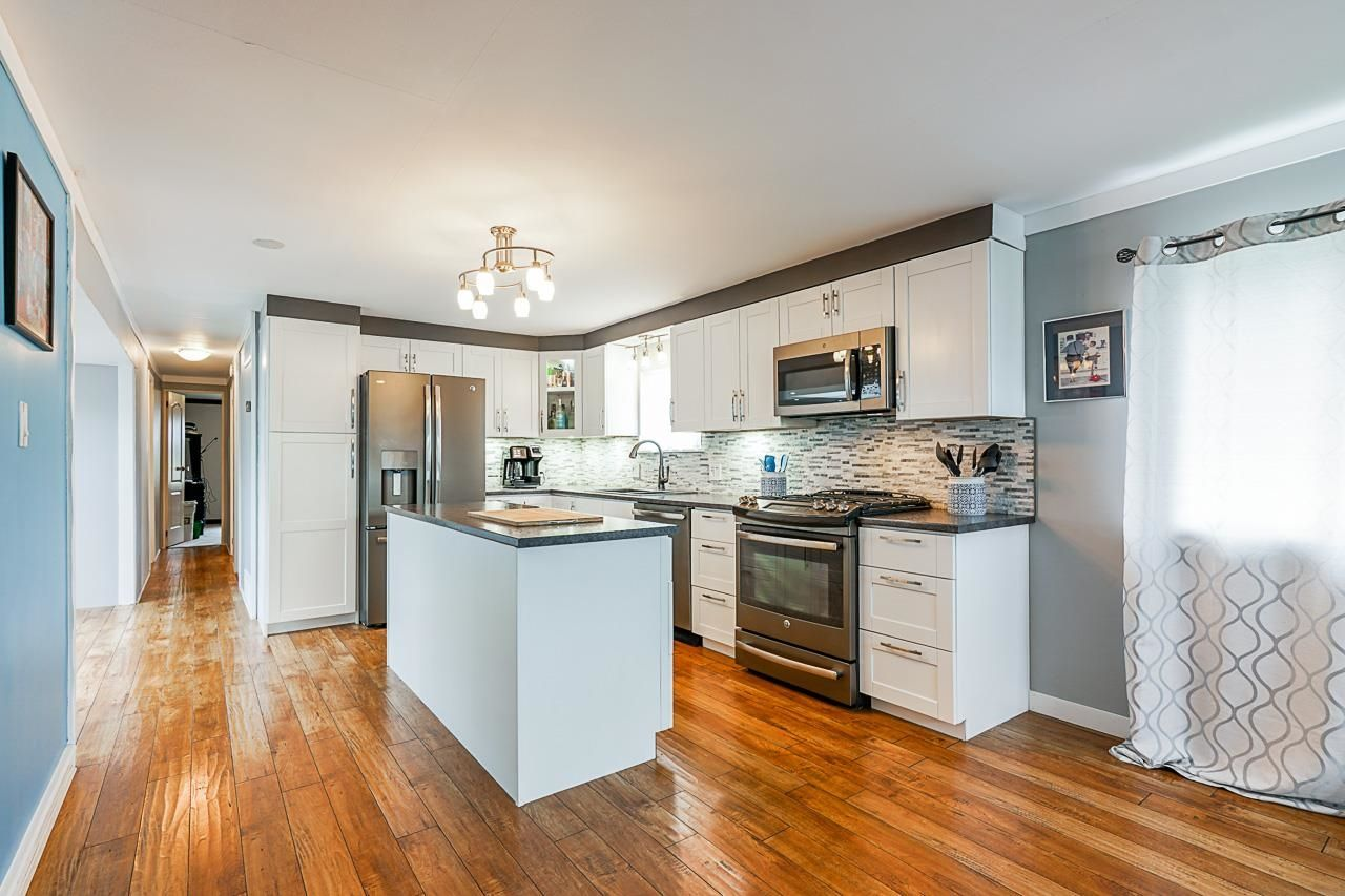 """Main Photo: 36 201 CAYER Street in Coquitlam: Maillardville Manufactured Home for sale in """"WILDWOOD MANUFACTURED HOME PARK"""" : MLS®# R2619875"""