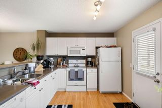 Photo 13: 69 Tuscany Springs Gardens NW in Calgary: Tuscany Row/Townhouse for sale : MLS®# A1112566