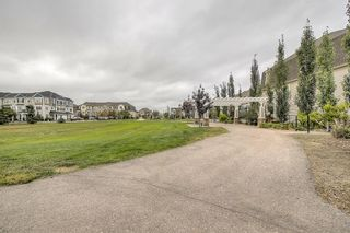 Photo 41: 129 Windstone Park SW: Airdrie Row/Townhouse for sale : MLS®# A1137155