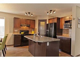 Photo 7: 110 AUTUMN Green SE in CALGARY: Auburn Bay Residential Attached for sale (Calgary)  : MLS®# C3566172