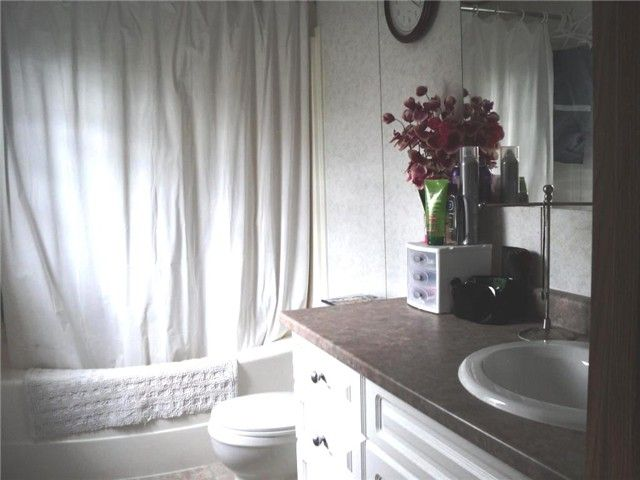 """Photo 8: Photos: 43 5701 AIRPORT Drive in Fort Nelson: Fort Nelson -Town Manufactured Home for sale in """"SOUTHRIDGE MOBILE HOME PARK"""" (Fort Nelson (Zone 64))  : MLS®# N212129"""