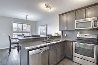 Photo 10: 731 101 Sunset Drive: Cochrane Row/Townhouse for sale : MLS®# A1077505