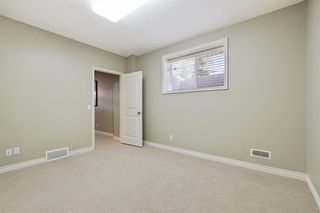 Photo 37: 36 Versailles Gate SW in Calgary: Garrison Woods Row/Townhouse for sale : MLS®# A1098876