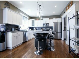 """Photo 4: 4342 BLAUSON Boulevard in Abbotsford: Abbotsford East House for sale in """"AUGUSTON"""" : MLS®# F1417968"""