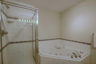 Photo 18: 13 Strathearn Gardens SW in Calgary: Strathcona Park Semi Detached for sale : MLS®# A1114770