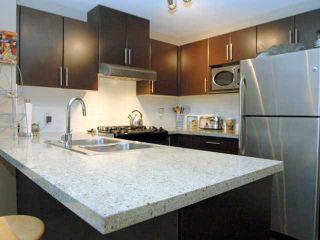 """Photo 3: 404 700 KLAHANIE Drive in Port Moody: Port Moody Centre Condo for sale in """"BOARDWALK"""" : MLS®# V911604"""