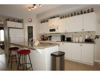 Photo 21: 155 CRAWFORD Drive: Cochrane House for sale : MLS®# C4092224