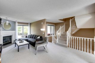 Photo 2: 81 Coachway Gardens SW in Calgary: Coach Hill Row/Townhouse for sale : MLS®# A1147900