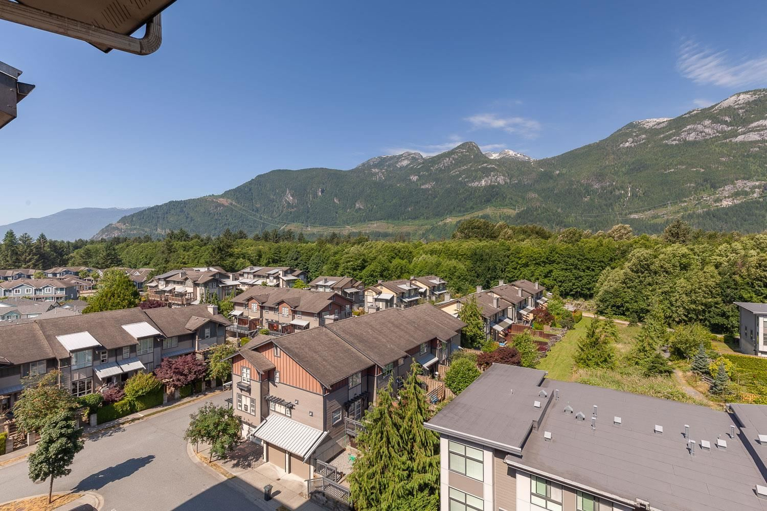 """Main Photo: 603 1211 VILLAGE GREEN Way in Squamish: Downtown SQ Condo for sale in """"ROCKCLIFF"""" : MLS®# R2573545"""