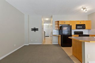 Photo 4: 94 Everridge Gardens SW in Calgary: Evergreen Row/Townhouse for sale : MLS®# A1069502