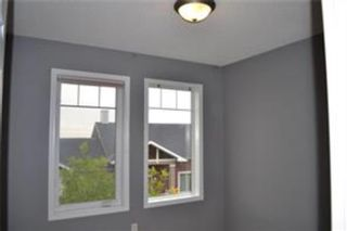 Photo 17: 92 Panamount Drive NW in Calgary: Panorama Hills Row/Townhouse for sale : MLS®# A1122234