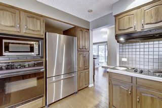 Photo 9: 607 Stratton Terrace SW in Calgary: Strathcona Park Row/Townhouse for sale : MLS®# A1065439