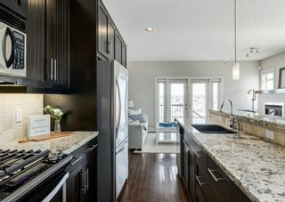Photo 6: 106 1312 Russell Road NE in Calgary: Renfrew Row/Townhouse for sale : MLS®# A1080835