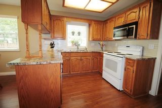 """Photo 5: 4606 221A Street in Langley: Murrayville House for sale in """"Murrayville"""" : MLS®# R2179708"""
