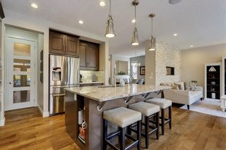 Photo 11: 291 TREMBLANT Way SW in Calgary: Springbank Hill Detached for sale : MLS®# C4199426