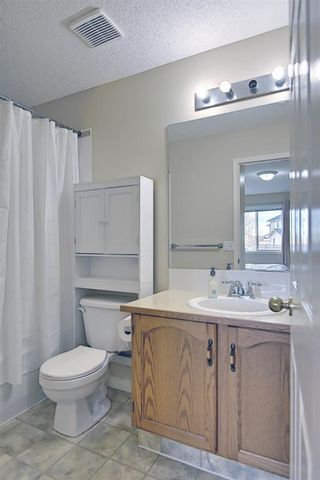 Photo 24: 154 WEST CREEK Bay: Chestermere Semi Detached for sale : MLS®# A1077510