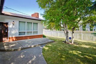 Photo 6: 7208 11 Street SW in Calgary: Kelvin Grove Detached for sale : MLS®# A1079702