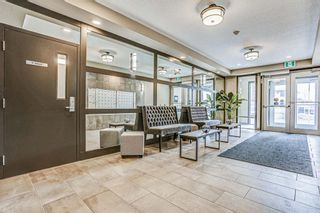 Photo 4: 205 8530 8A Avenue SW in Calgary: West Springs Apartment for sale : MLS®# A1080205