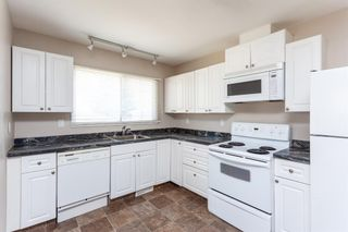 Photo 2: 9816 Fairmount Drive SE in Calgary: Acadia Detached for sale : MLS®# A1094940