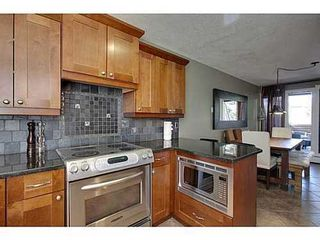 Photo 8: 6 828 COACH BLUFF Crescent SW in Calgary: 2 and Half Storey for sale : MLS®# C3560991