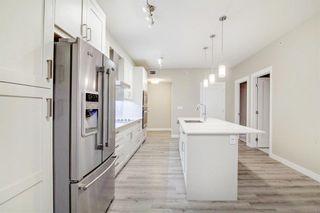 Photo 7: 404 200 Auburn Meadows Common SE in Calgary: Auburn Bay Apartment for sale : MLS®# A1151745