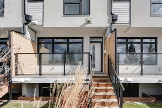 Photo 2: 104 1616 24th Ave NW in Calgary: Capitol Hill Row/Townhouse for sale : MLS®# A1104099