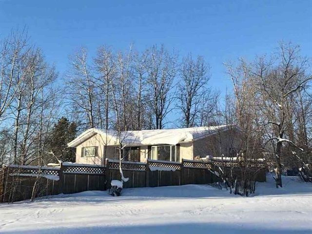 """Main Photo: 5519 51 Street in Fort Nelson: Fort Nelson -Town House for sale in """"HILL"""" (Fort Nelson (Zone 64))  : MLS®# R2553120"""