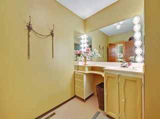 Photo 12: 75 Anatapi Lane SW in Calgary: Springbank Hill Detached for sale : MLS®# A1099057
