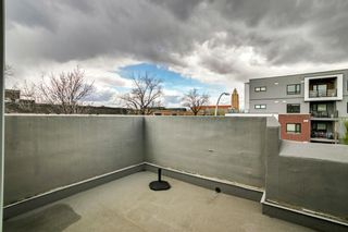 Photo 34: 100 18 Avenue SE in Calgary: Mission Row/Townhouse for sale : MLS®# A1100251
