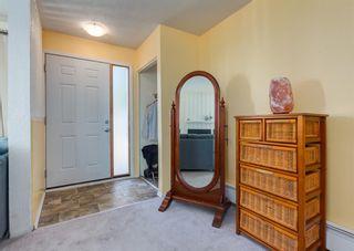 Photo 3: 308 219 Huntington Park Bay NW in Calgary: Huntington Hills Row/Townhouse for sale : MLS®# A1147947