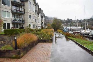 "Photo 1: 110 1466 PEMBERTON Avenue in Squamish: Downtown SQ Condo for sale in ""MARINA ESTATES - STARBOARD"" : MLS®# R2121674"