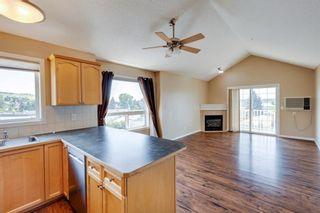 Photo 5: 402 128 Centre Avenue: Cochrane Apartment for sale : MLS®# A1129690