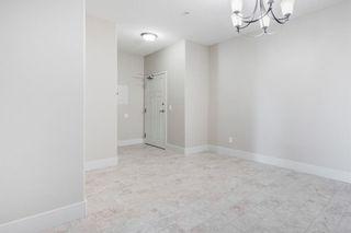 Photo 2: 306 77 George Fox Trail: Cochrane Apartment for sale : MLS®# A1139159
