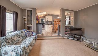 Photo 4: 111 Heritage Drive: Okotoks Mobile for sale : MLS®# A1102220